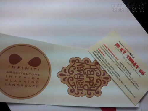 Một mẫu in thử họa tiết tết, happy new year trên giấy mỹ thuật