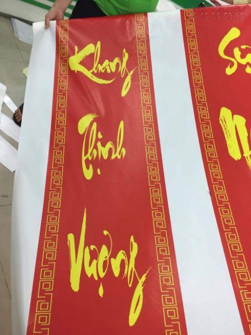 In câu liễn chúc mừng năm mới với dịch vụ in silk giá rẻ tại In Kỹ Thuật Số
