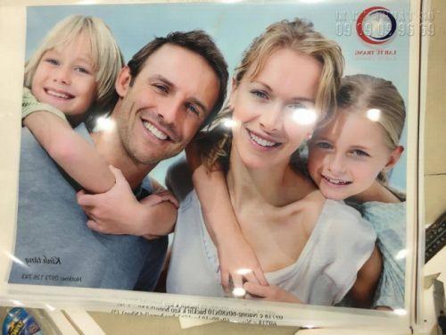 In backlit film HCM làm phông nền xuyên sáng tại trung tâm nha khoa